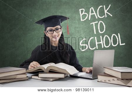 Student With Mortarboard Back To School And Studying