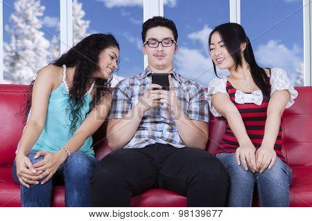 Two Girls Peeking A Man Sends Message