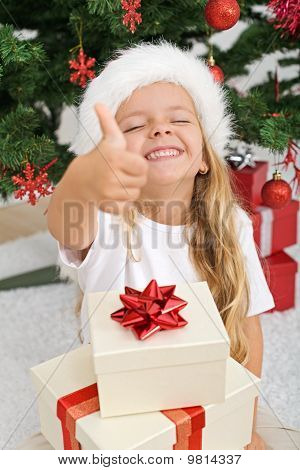 Extremely Happy Litte Girl With Christmas Present