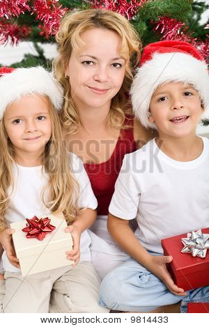 Woman And Kids At Christmas Time