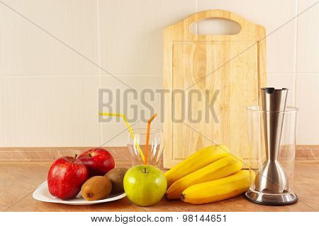 Fresh fruit glasses and blender to prepare fresh