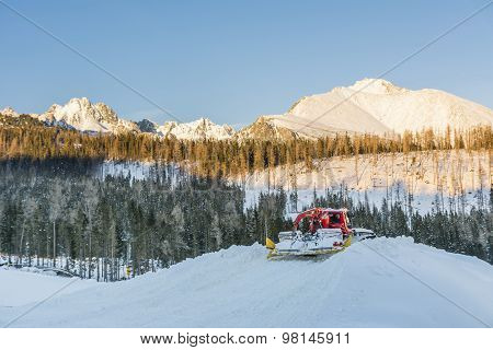 Red Snowmobile In The Mountains