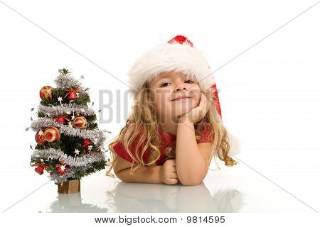 Little Girl With Small Christmas Tree