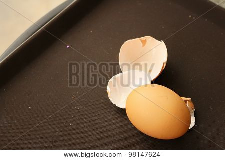 Eggs And Eggshell Isolated On Brown Background