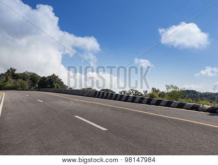 Asphalt Roadway With Cloud Blue Sky Background
