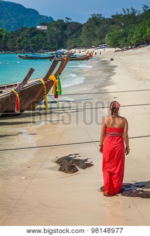 .woman On Tropical Beach Relaxing And Watching Longtail Boats, Andaman Sea, Thailand
