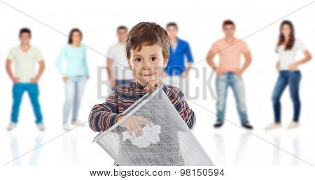 Funny kid throwing a role in the bin with young people of background unfocused