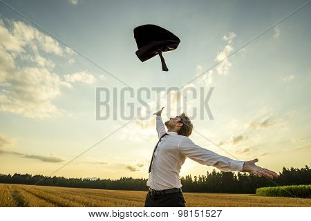 Happy Businessman Throwing His Coat For Being Free