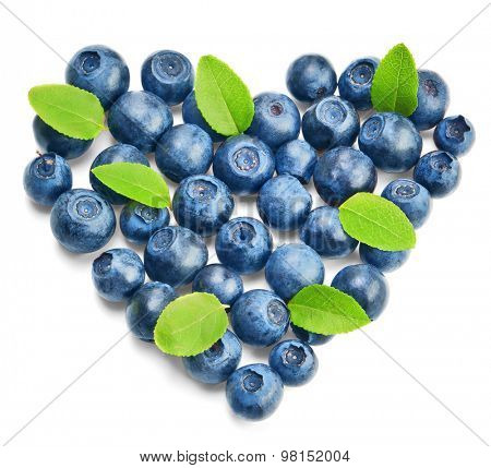 Fresh blueberries with green leaves isolated on white