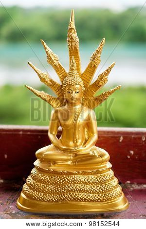 Golden Buddha Statue With The King Of Nagas
