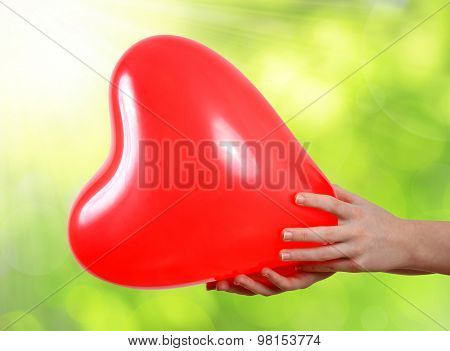 Balloon in the shape heart in hands