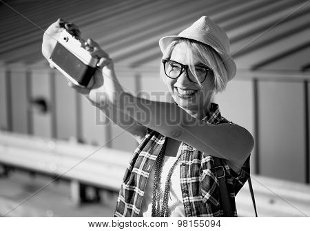 Smiling Hipster Girl Making Selfie On Vintage Film Camera