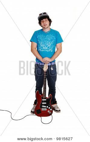 Boy Standing With Guitar.