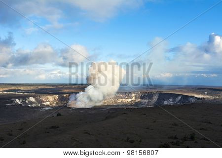 Kilauea volcano exploding after an earthquake spills rocks into the molten lava of the active vent within the caldera.
