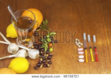 Rosehip tea and flu vaccination. Traditional medicine and modern treatment methods.