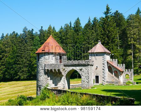 Two towers of small forest castle Masun