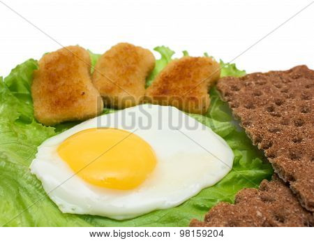 Breakfast Copy Space: Fried Egg, Lettuce, Crisp Bread And Nuggets