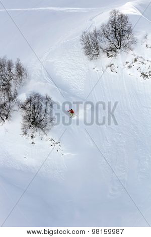 Skier in deep powder, extreme mountain freeride