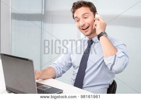 Call center operator holding mobile phone