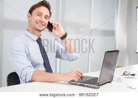Call center operator holding mobile phone