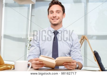 Call center operator holding book