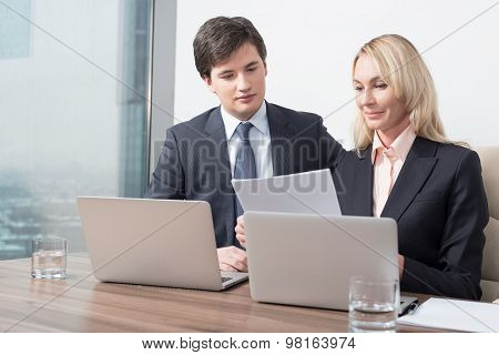 Business Couple Is Double Checking Some Essential Business Information. Panoramic Office.