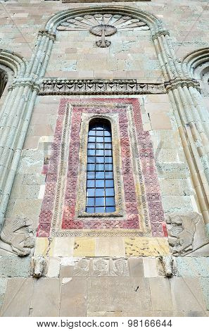 Detail facade design of the Svetitskhoveli Cathedral - stone bull heads, remains of the Basilica of