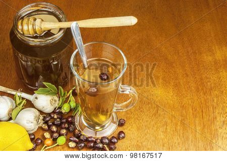 Traditional home treatment for colds and flu. Rosehip tea, garlic, honey and citrus.