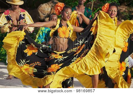 People perform traditional creole Sega dance at sunset in Mauritius.