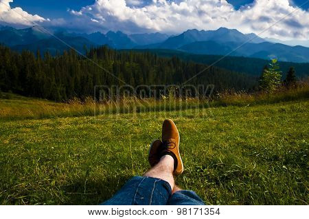 Man Relaxing, Enjoying Mountain Landscape On Sunny Day