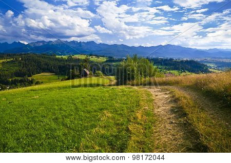 Path In A Mountain Landscape - Hiking On Sunny Day