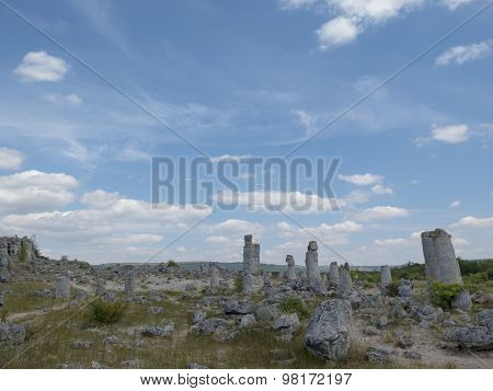 High Stone Pillars On The Background Of Blue Sky, Forming A Stone Forest