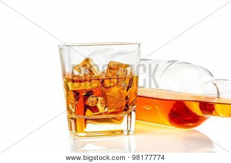 Whiskey Near Bottle On White Background With Reflection