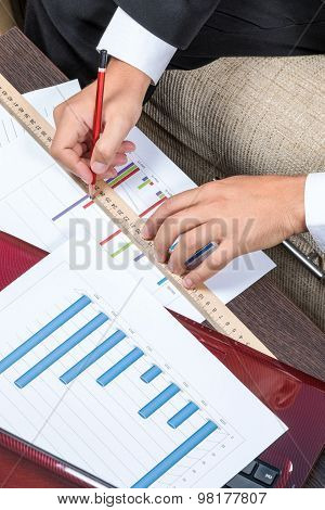 Businessman Studying A Graph