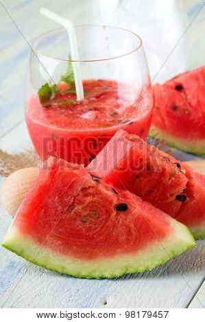 Couple Of Melon Slices In Front Of Fruit Smoothie