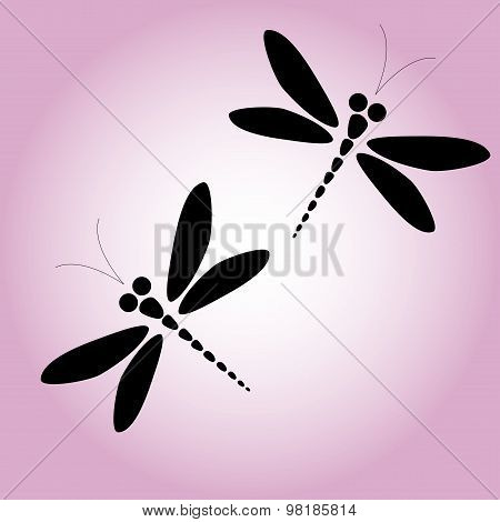 Two vector black dragonflies on the pink background
