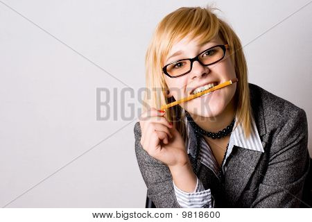 Young Businesswoman With Pencil