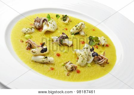 Fish Dish Cream Of Jerusalem Artichokes With Saffron And Squid With Herbs