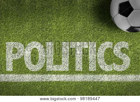 Soccer field with the text: Politics