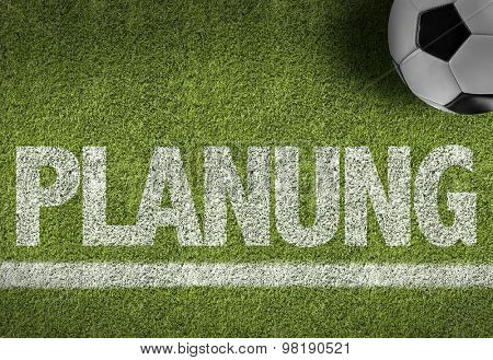 Soccer field with the text: Planning (in German)