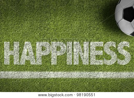 Soccer field with the text: Happiness