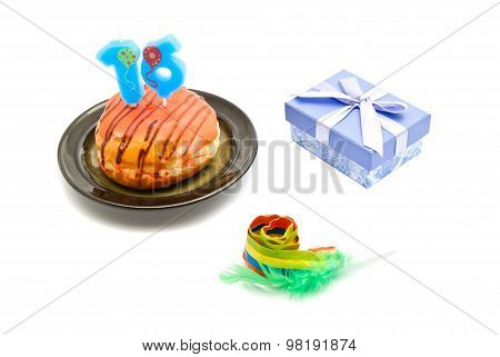 Donut With Sixteen Years Birthday Candle, Whistle And Gift On White