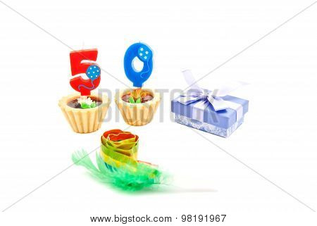 Cakes With Fifty Years Birthday Candles, Whistle And Gift On White