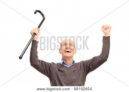 Overjoyed senior holding a black cane an looking up isolated on white background