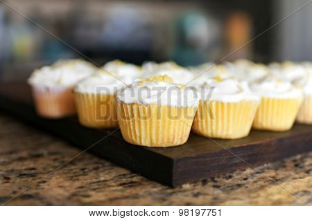 Lemon Cupcakes on Wooden Serving Board
