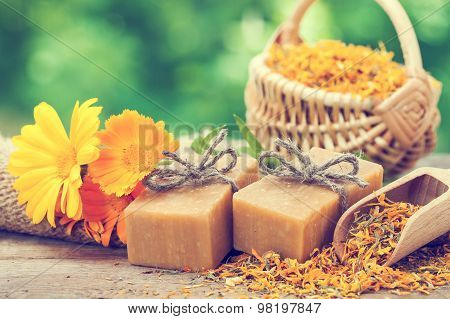 Bars Of Homemade Soaps And Calendula Flowers. Vintage Stylized Photo.