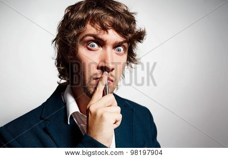 Closeup Portrait Young Puzzled Business Man Thinking Deciding Deeply About Something Finger On Lips