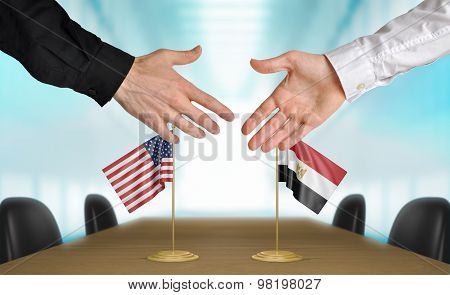 United States and Egypt diplomats agreeing on a deal