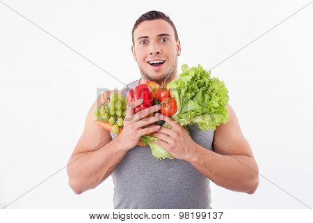 Attractive young guy is fond of fruits and vegetables