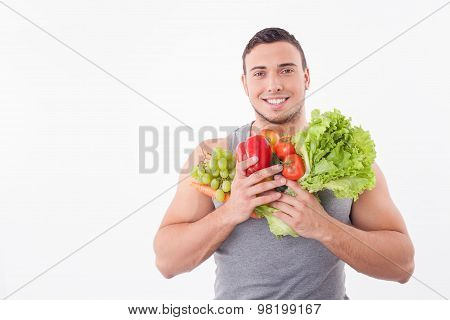 Handsome fit young man likes healthy eating